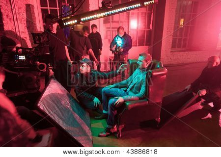 MOSCOW - OCT 23: Director, staff and actors on the set of the video singer Rene during scene with a man on a chair in White studio on October 23, 2010 in Moscow, Russia.