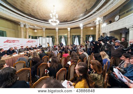 MOSCOW - DECEMBER 2: Popular actors give interview about film Master and Margarita sitting at table in press private residence Arguments and Facts on December 2, 2010 in Moscow, Russia.