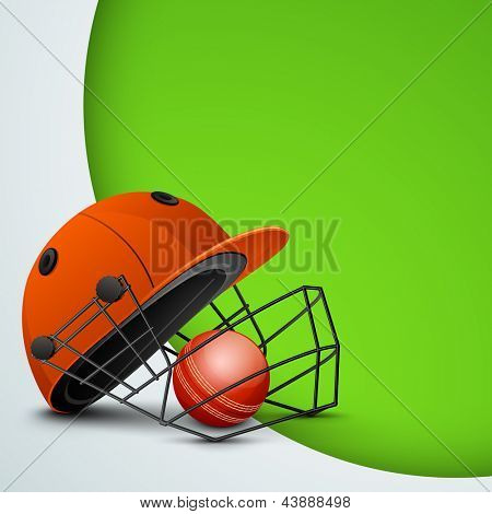 Sports concept with cricket helmet with ball on abstract green background.