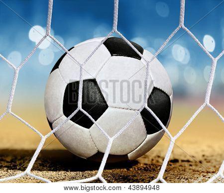closeup soccer ball on ground near goal-area