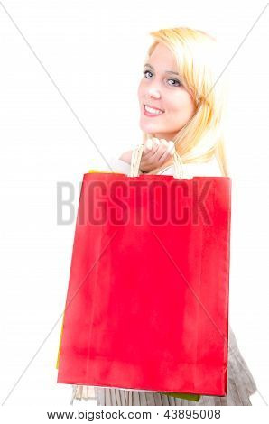 Happy Beautiful Blonde Caucasian Young Woman With Shopping Bags