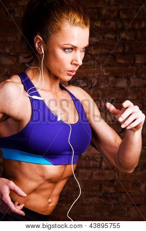 strong woman is running and listening music