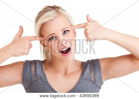 Young cute girl showing crazy sign isolated on white