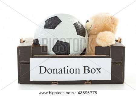 Black cardboard with football and stuffed bear on white background