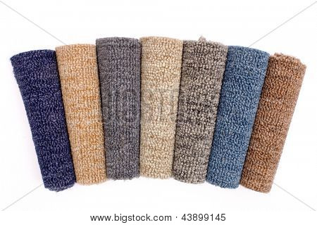 Photo of colorful carpet rolls