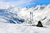 picture of knapsack  - Skis ski poles and backpack in Hochgurgl ski resort in Otztal Alps Tirol Austria - JPG