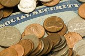 picture of social-security  - Picture of social security card surrounded by old pennies nickels dimes quarters - JPG