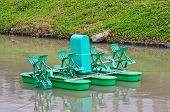 stock photo of aeration  - Paddle Wheel Aerator for oxygen in the water - JPG