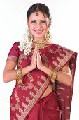stock photo of indian sari  - Teenage indian girl in red sari with welcome posture - JPG