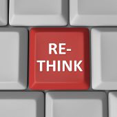 A red computer key with the word Re-Think to illustrate the need to reconsider and reevaluate an imp