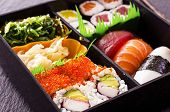 stock photo of masago  - sushi and rolls in bento box - JPG