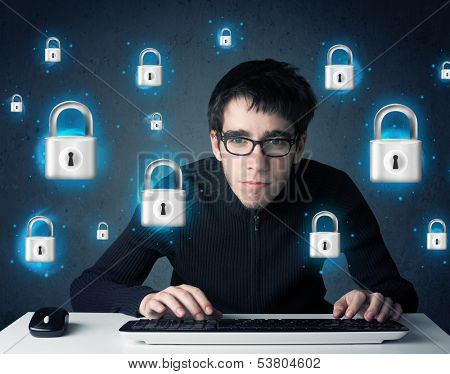 Young hacker with virtual lock symbols and icons on blue background