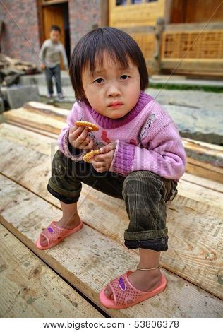 Asian Child Girl 4 Years Old, Holding Cookie, In Countryside.