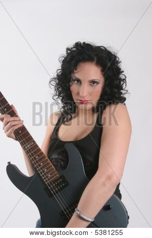 Pretty Spanish Woman With Her Guitar