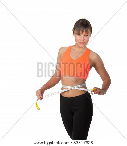 Beautiful Slim Woman Measuring Her Waistline With A Measuring Tape