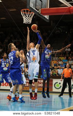 KAPOSVAR, HUNGARY �¢�?�? OCTOBER 26: Jancsikin Branislav (white 10) in action at a Hungarian Championship basketball game with Kaposvar (white) vs. Fehervar (blue) on October 26, 2013 in Kaposvar, Hungary.