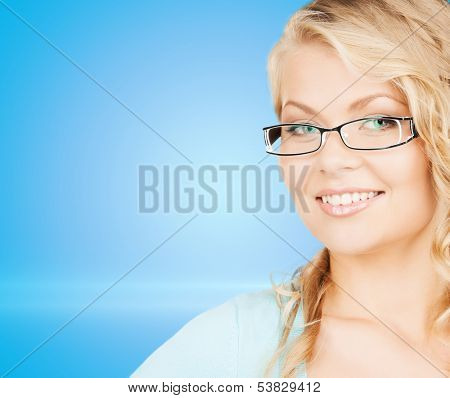 health and vision concept - close up of beautiful young woman wearing eyeglasses