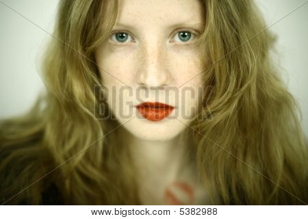 Charming Red Girl With Freckles