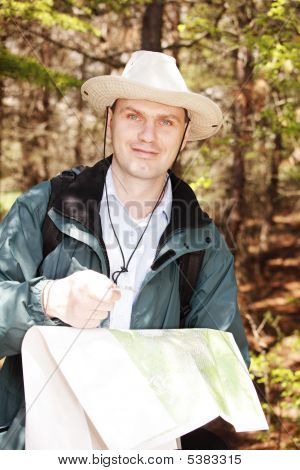 Hiker With Map And Compass