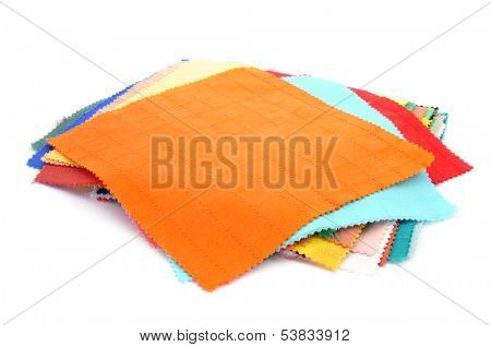 square pieces of fabric with different colors and patterns on a white background