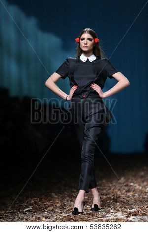 Fashion model wearing clothes designed by Borna and Fils on the Cro a Porter show on October 25, 2013 in Zagreb, Croatia.