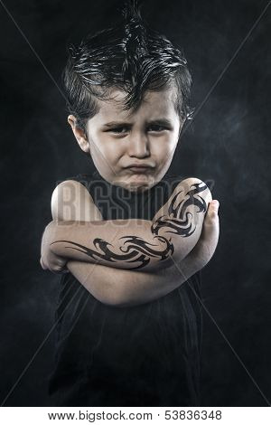 Tattooed boy, rebellious child, funny guy with slicked back hair and rocker look