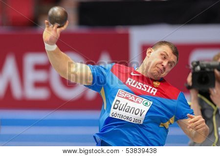 GOTHENBURG, SWEDEN - MARCH 1 Aleksandr Bulanov (Russia) places 6th in the men's shot put final during the European Athletics Indoor Championship on March 1, 2013 in Gothenburg, Sweden.