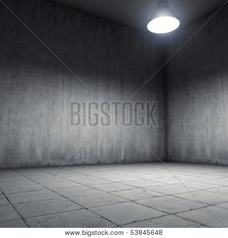 Concrete room illuminated by lamp