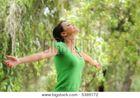 Young Woman In Green Forest