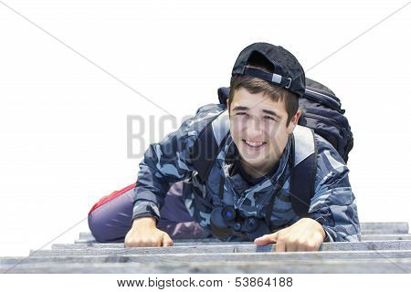 Boy climbing on wooden stairs on a white background