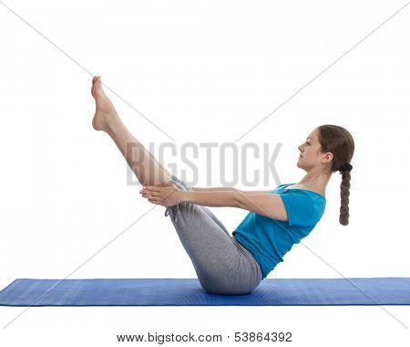 Yoga - young beautiful woman yoga instructor doing Full Boat pose asana (Paripurna navasana) exercise isolated on white background