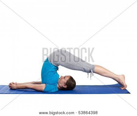Yoga - young beautiful woman yoga instructor doing Plow pose asana (halasana) exercise isolated on white background