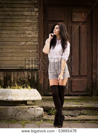 Fashion Pretty Young Woman Posing Outdoor In Stockings