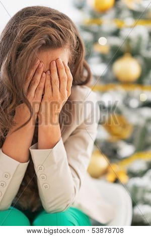 Stressed Young Woman Near Christmas Tree