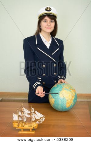 Girl In A Uniform Of Sea Captain With Globe