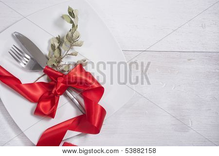 Festive Table Setting And Decoration With Red Ribbon