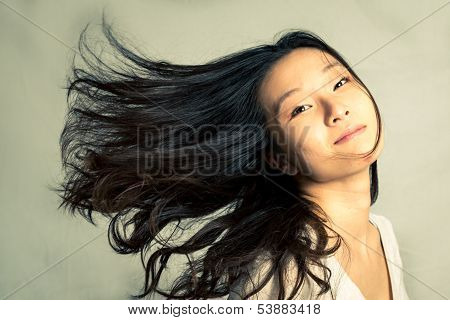 Woman flicking her hair