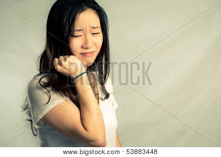 Woman crying and pulling hair