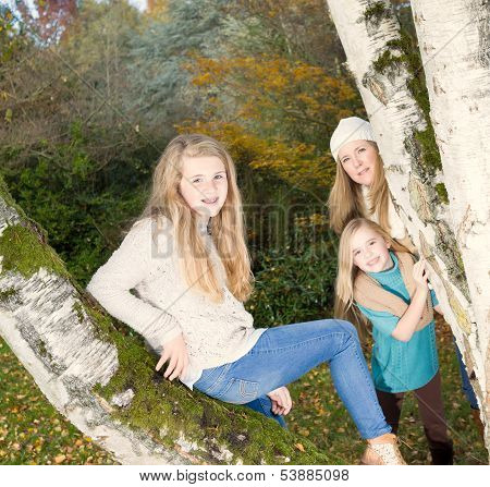 Oldest Daughter Posing With Mom And Younger Sister Looking On