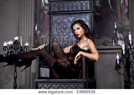 Glamor lady sits on the throne in the church