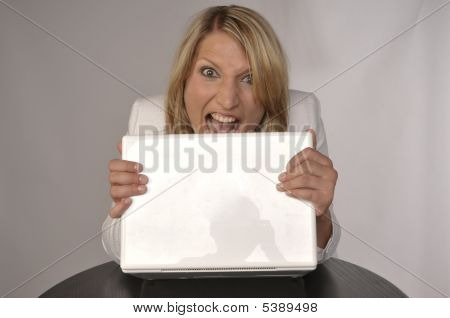 Angry Blond Woman With Laptop