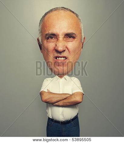 funny picture of angry senior man over grey background