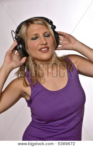 Blond Woman Listening On Headphones