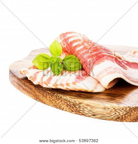 Delicious   Italy Prosciutto Bacon On Wooden Cutting Board  Isolated On White Background, Close Up.