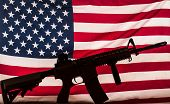 assault rifle silhouette on american flag