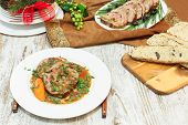 stock photo of veal meat  - Veal rolls with bacon stuffing and vegetables - JPG