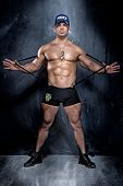 picture of policeman  - Muscular naked policeman posing lookign at camera - JPG