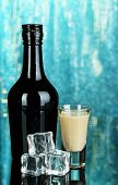 picture of bailey  - Baileys liqueur in bottle and glass on blue background - JPG