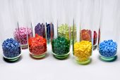 stock photo of thermoplastics  - several dyed polymer resins in test glasses in laboratory - JPG