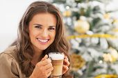 Portrait Of Happy Young Woman With Latte Macchiato In Front Of C